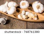 garlic  garlic cloves and... | Shutterstock . vector #768761380