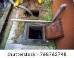 emptying household septic tank. ... | Shutterstock . vector #768762748