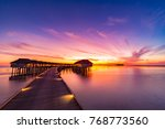sunset on maldives island ... | Shutterstock . vector #768773560