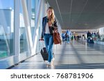 Small photo of Happy woman traveling and walking in airport