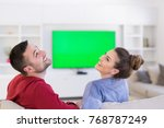 young couple on the sofa... | Shutterstock . vector #768787249