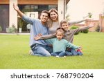happy family sitting on green... | Shutterstock . vector #768790204