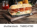 tasty sandwich with prosciutto... | Shutterstock . vector #768814780