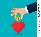hand put money into heart... | Shutterstock .eps vector #768817990