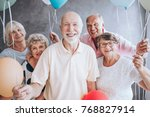 smiling elderly man and his... | Shutterstock . vector #768827914
