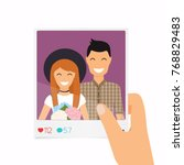 hand holds a photo with a... | Shutterstock .eps vector #768829483