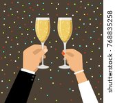 hands holding champagne and... | Shutterstock .eps vector #768835258
