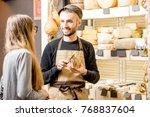 salesman with a woman customer... | Shutterstock . vector #768837604