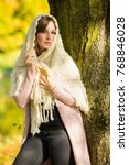 portrait of a brunette young...   Shutterstock . vector #768846028