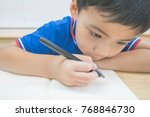 little kid is writing at the...   Shutterstock . vector #768846730