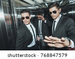 bodyguard stopping paparazzi... | Shutterstock . vector #768847579