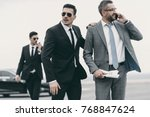 businessman walking with two... | Shutterstock . vector #768847624