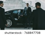 bodyguard in sunglasses opening ... | Shutterstock . vector #768847708