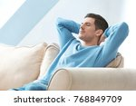 happy young man relaxing at home | Shutterstock . vector #768849709