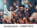 group of friends celebrating... | Shutterstock . vector #768857824