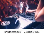 cropped shot of a dj playing... | Shutterstock . vector #768858433