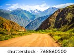 mountain road spring ranges... | Shutterstock . vector #768860500