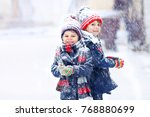 two little kid boys in colorful ... | Shutterstock . vector #768880699