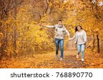 young couple running along park ... | Shutterstock . vector #768890770