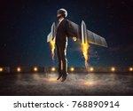 businessman wear a rocket suit... | Shutterstock . vector #768890914