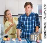 Small photo of Upset man and frustrated housewife having bad argument indoors