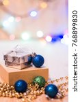 gift boxes and christmas balls...   Shutterstock . vector #768899830