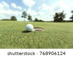 close up of golf ball on grass  | Shutterstock . vector #768906124