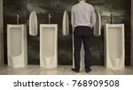 man peeing to toilet bowl in...   Shutterstock . vector #768909508