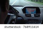 inside a car. a gps module is... | Shutterstock . vector #768911614