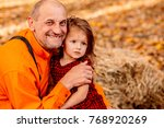 the grandfather embracing his... | Shutterstock . vector #768920269