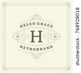 ornament monogram logo design... | Shutterstock .eps vector #768928018