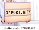 business woman hold light box... | Shutterstock . vector #768934570