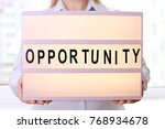 Small photo of Business woman hold light box with opportunity word on it. Opportunity, chance concept