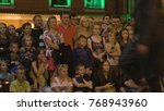 Small photo of Lublin, Poland - July 2017: Krystian Minda Sword Swallower Show in Lublin at night, during Festival Sztukmistrzow. Moves in front of the camera, slightly out of focuse. Crowd stays and sits on the