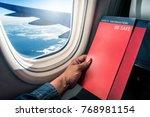 asian man read flight safety... | Shutterstock . vector #768981154