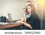 business  woman holding digital ... | Shutterstock . vector #769012960