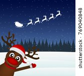 reindeer waving his paw in the... | Shutterstock .eps vector #769040848