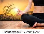 woman meditating on wood floor...   Shutterstock . vector #769041640