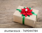 brown gift box with red and... | Shutterstock . vector #769044784