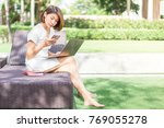asian woman working on her... | Shutterstock . vector #769055278
