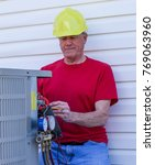 air conditioning hvac worker... | Shutterstock . vector #769063960
