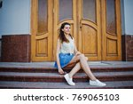 curly stylish girl wear on blue ... | Shutterstock . vector #769065103