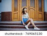 curly stylish girl wear on blue ... | Shutterstock . vector #769065130