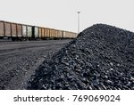 piles of coal next to a train... | Shutterstock . vector #769069024