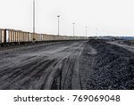 piles of coal next to a train... | Shutterstock . vector #769069048