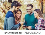 image of four happy smiling... | Shutterstock . vector #769082140