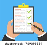 hand with black pen and... | Shutterstock .eps vector #769099984