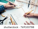 male and female working on... | Shutterstock . vector #769103788