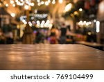 wood table top with blur of... | Shutterstock . vector #769104499