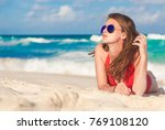 woman in bikini and straw hat... | Shutterstock . vector #769108120